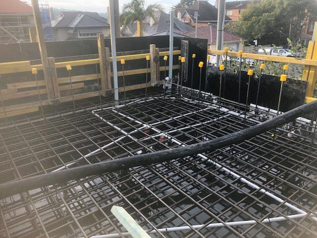 suspended garage concrete slab installation